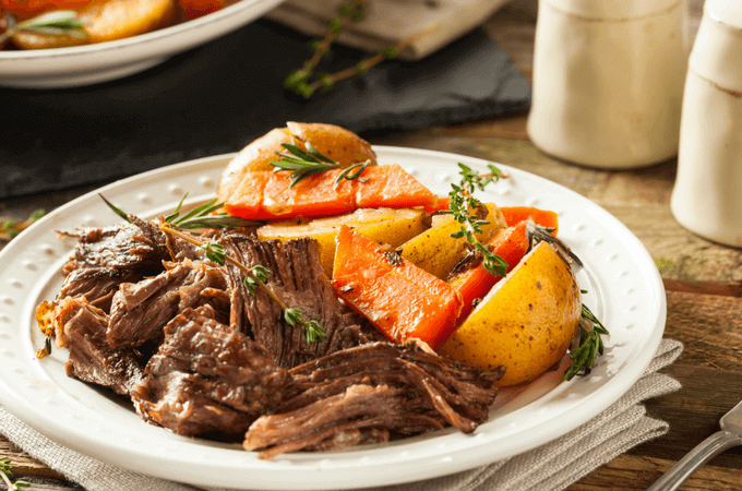 I love that this easy crockpot / slow cooker pot roast is so melty in my mouth! My love of beef pot roast goes back to my grandma - and this recipe is the best with red wine and just the perfect seasoning! The slow cooker saves the day! #slowcooker #potroast www.themidlilfemamas.com