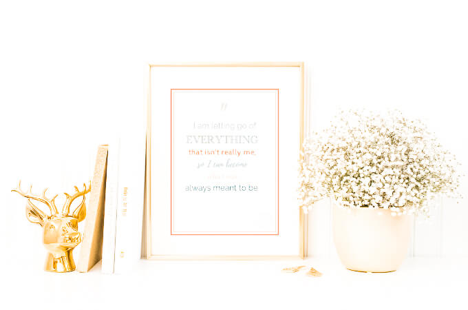 Picture of Framed Positive Affirmation with pot of flowers next to it