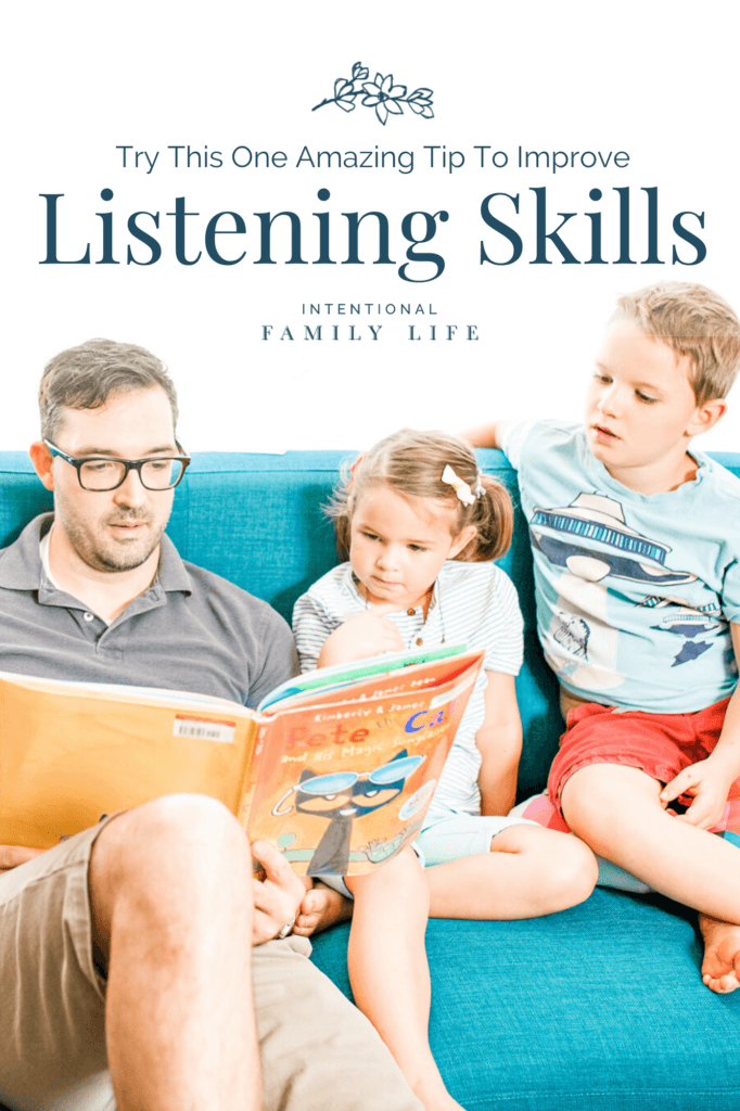 image of a father reading to his attentive children suggesting the concept of children developing listening skills