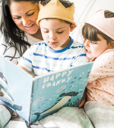 Image of mother reading children's bedtime stories