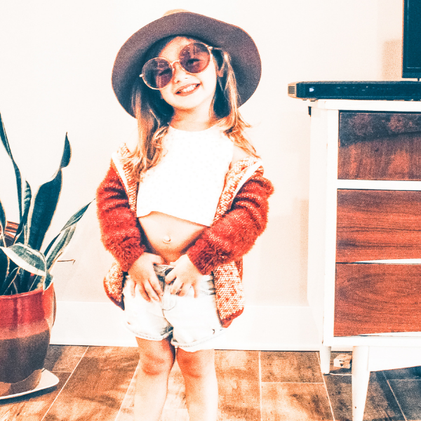 """Happy little girl in fun clothing and big sunglasses demonstrating a """"can do"""" attitude or a growth mindset in kids"""